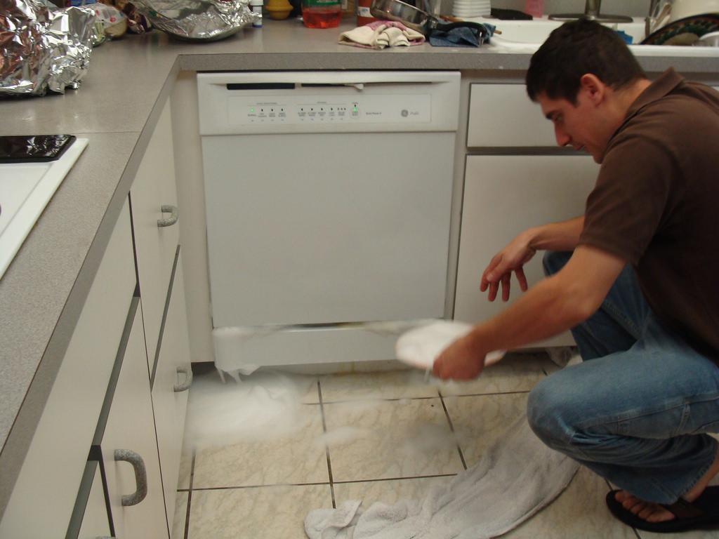 overflowing dishwasher photo